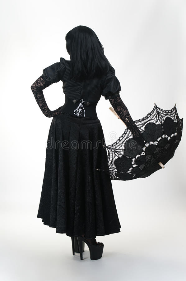Gothic vampire girl in black dress with umbrella. Gothic vampire girl in black dress with black umbrella stock images