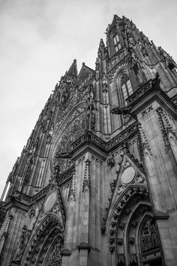 Gothic Vysehrad cathedral in Prague with beautiful stone statues in black and white. Beautiful stone statues on the front of the Gothic Vysehrad Visegrad royalty free stock image