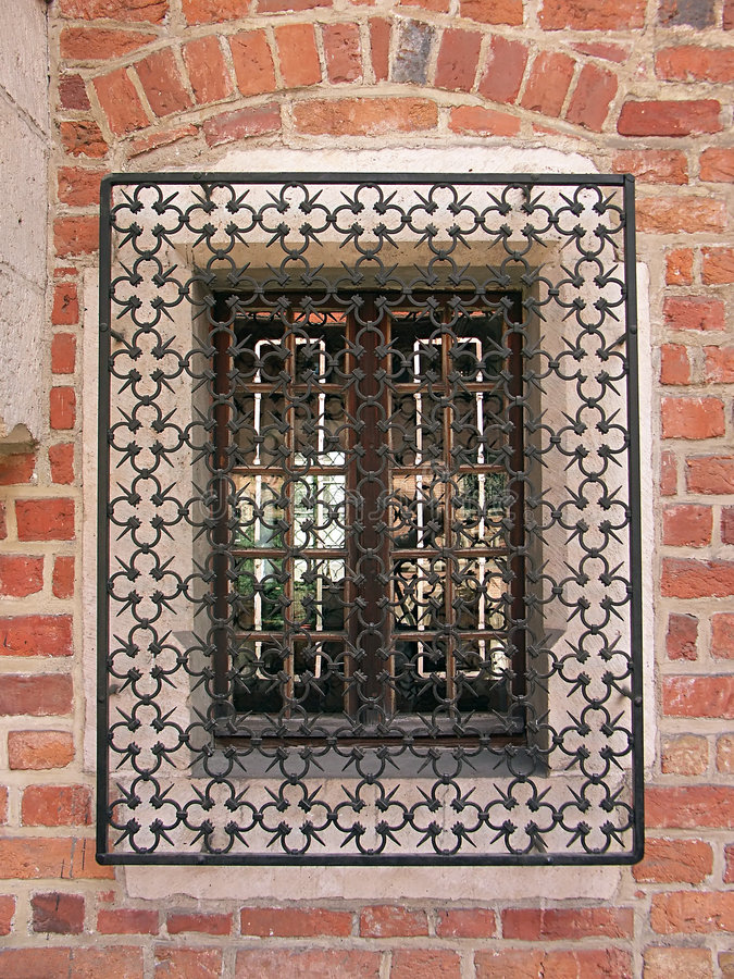 Gothic window. With ornamental grate stock photography