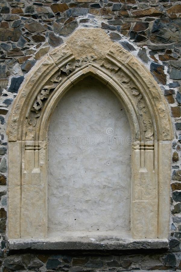 Gothic window. Arch set into the wall of the reconstructed rural church, near Prague, Czech Republic stock photos