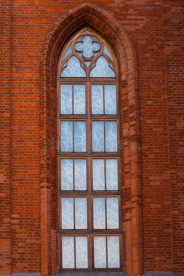 Gothic window, Gothic window red brick. Gothic window, glass, wooden frame, ed brick royalty free stock images