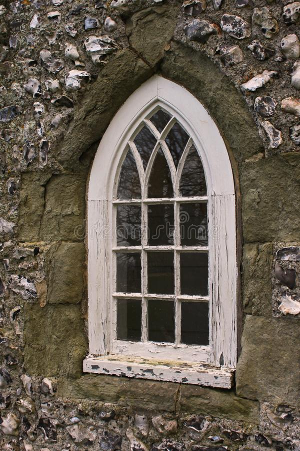 Gothic window at Lewes castle. Gothic window in a stone wall of Lewes castle stock photo