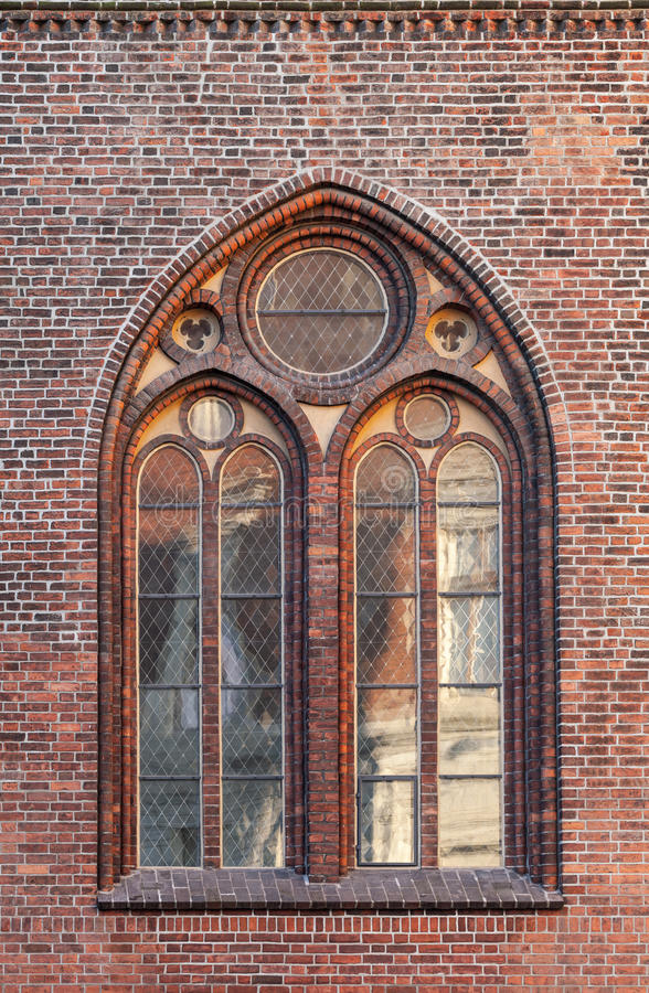 Gothic window in red brick wall. Of Dome Cathedral, Riga, Latvia stock photos