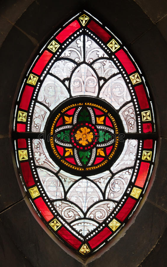 Gothic window from stained glass stock photography