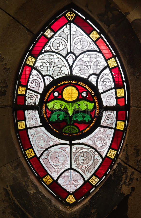 Gothic window from stained glass. Gothic ornamental stained glass window in a medieval church stock photos
