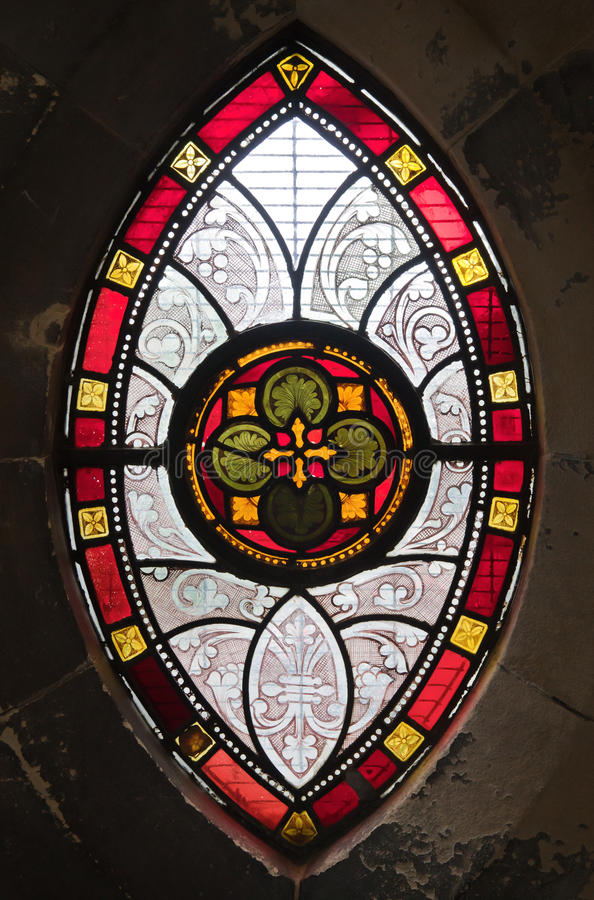 Gothic window from stained glass. Gothic ornamental stained glass window in a medieval church stock photo