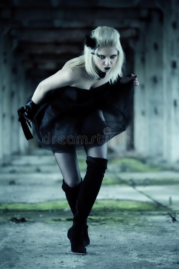 Gothic witch woman. With spooky make-up in black dress stock photos