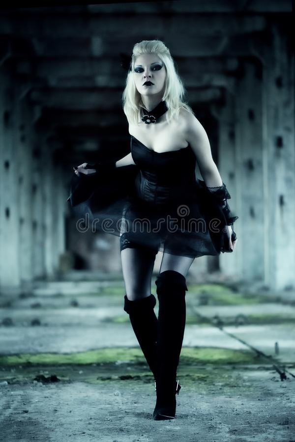 Gothic witch woman. With spooky make-up in black dress royalty free stock images