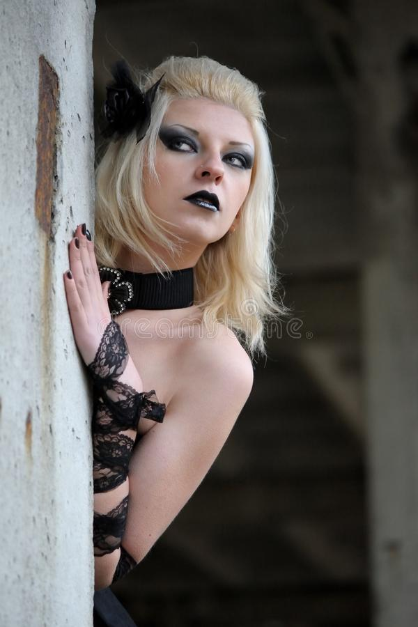 Gothic witch woman. With spooky make-up in black dress stock image