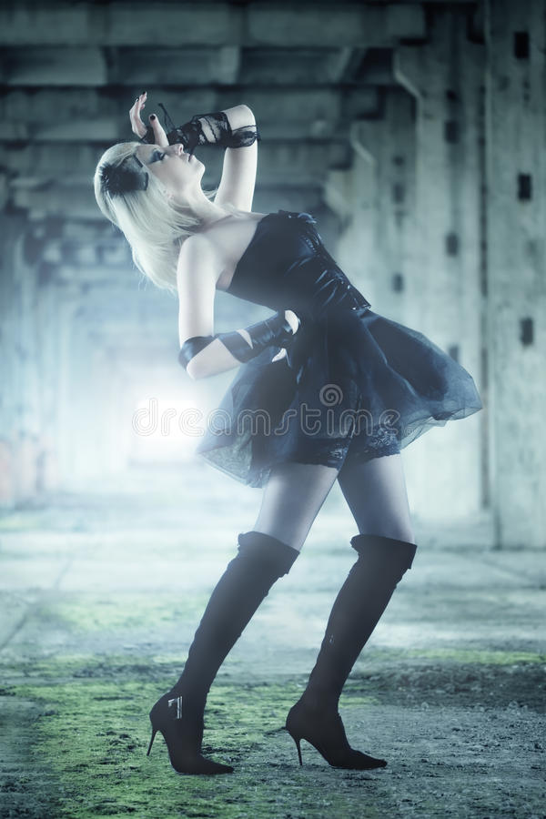 Gothic woman. In black dress royalty free stock photo