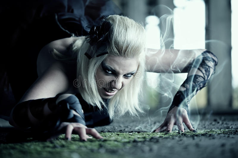 Gothic woman. Creep on the floor royalty free stock image