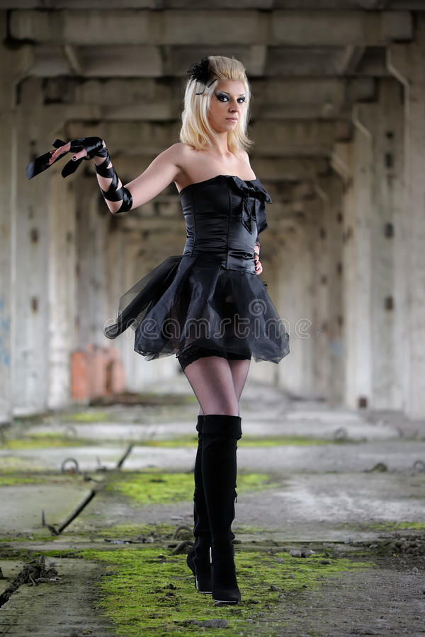 Gothic woman. In black dress stock photos