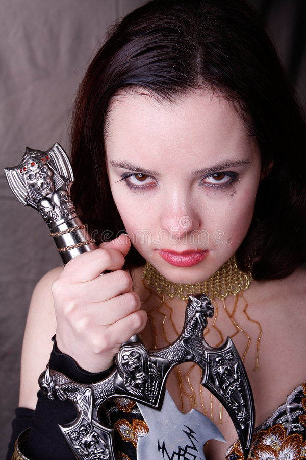 Gothic woman. With wet face sword royalty free stock photo