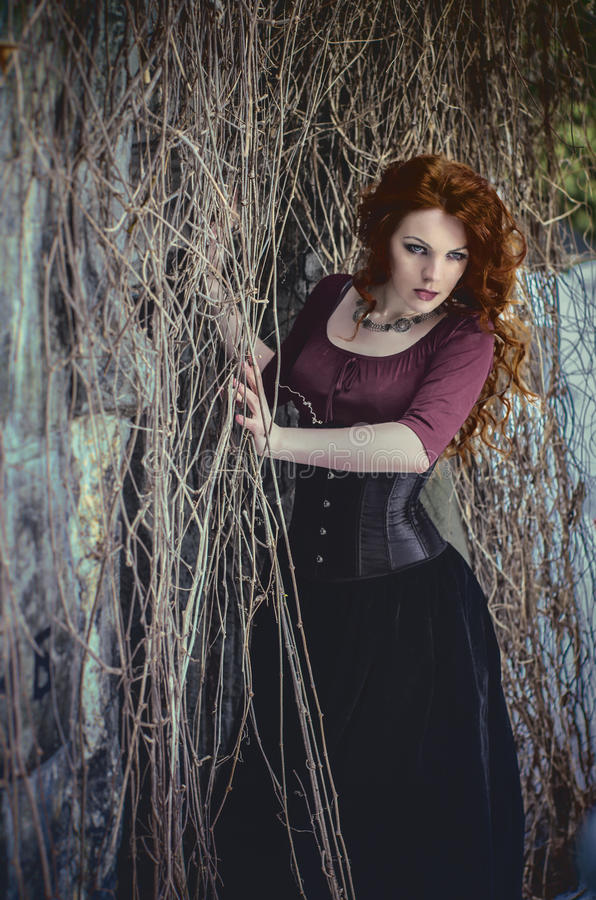 Gothic woman in black dress. Gothic beautiful woman in black dress royalty free stock photography