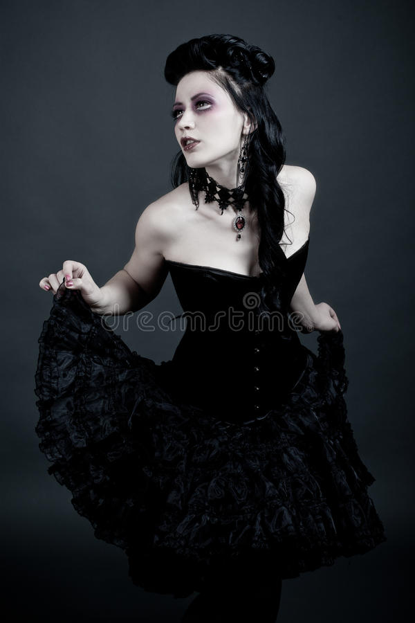Gothic woman dancing lost in thougts. Picture of a gothic woman dancing lost in thougts royalty free stock image