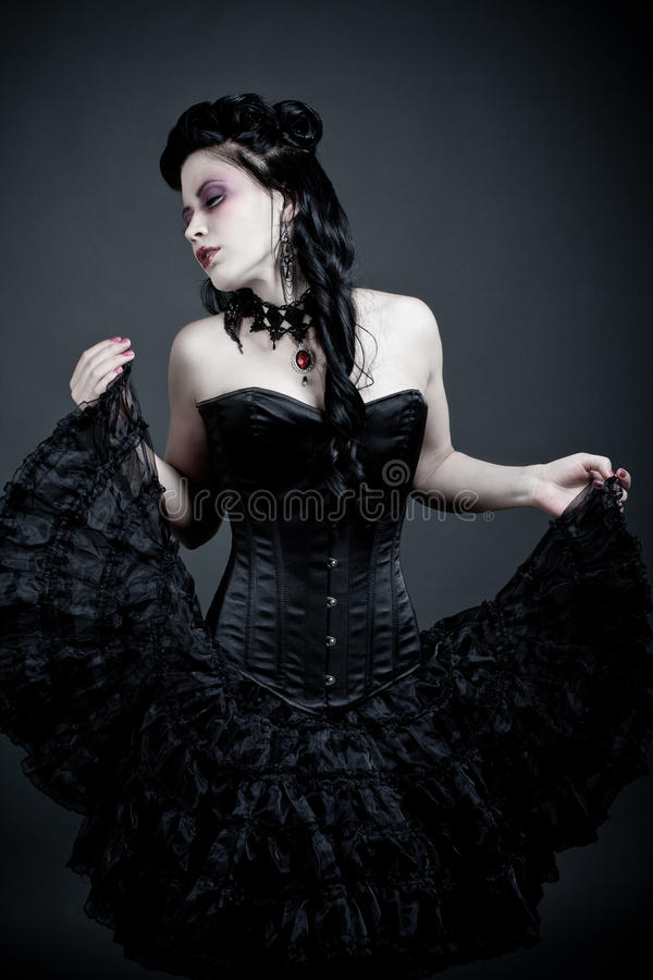 Gothic woman dancing lost in thougts. Picture of a gothic woman dancing lost in thougts stock image
