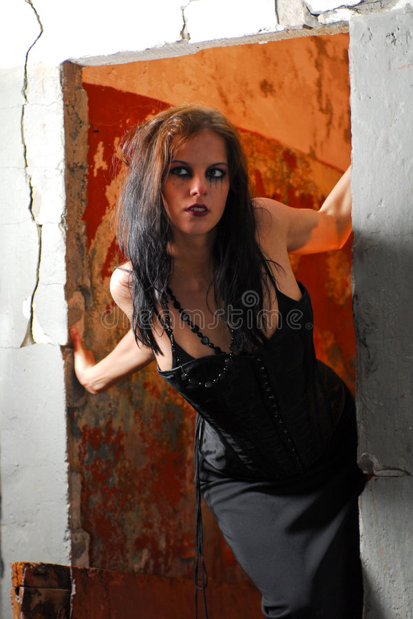 Gothic woman in doorway royalty free stock image