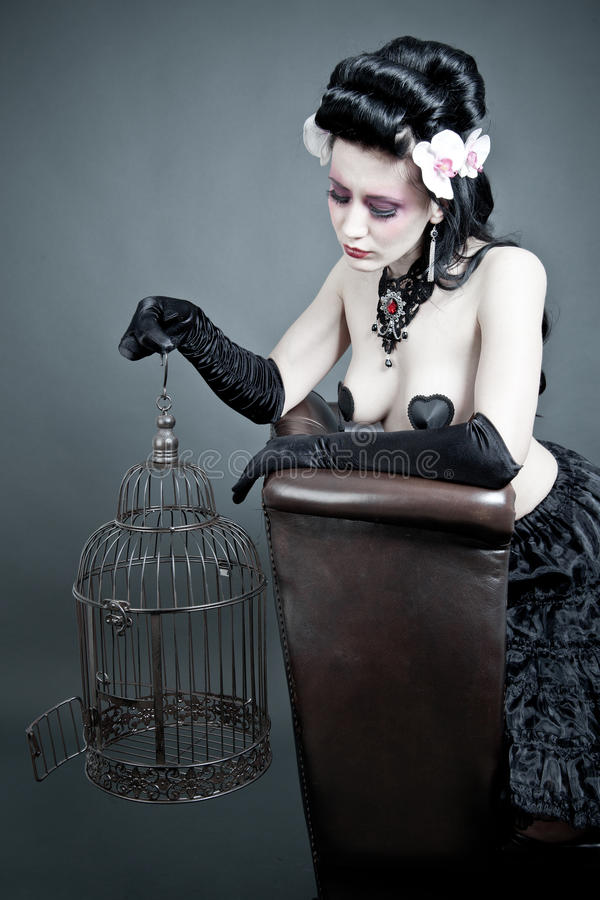 Gothic Woman with a empty birdcage royalty free stock images