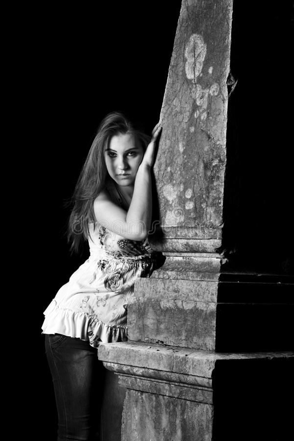 Gothic woman by the grave. Shot of Gothic woman by the grave, night shot, B&W royalty free stock photos