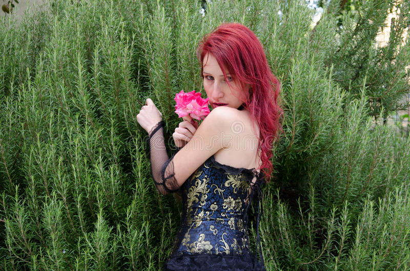 Gothic woman with rose. Portrait of gothic woman with rose stock photography