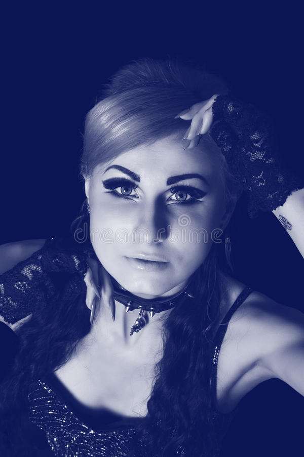 Gothic woman, toned portrait. Portrait of beautiful young gothic woman, toned blue stock images