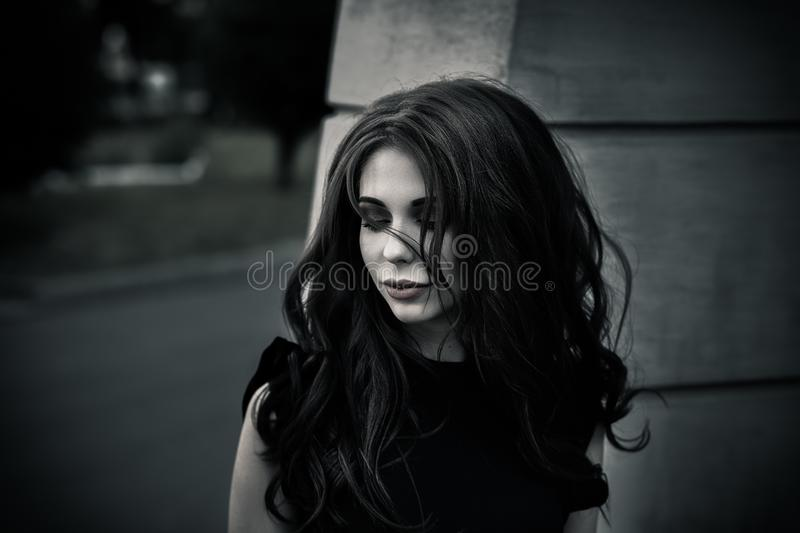 Gothic young woman. Gothic young brunette woman outdoors, shallow depth of field royalty free stock photography