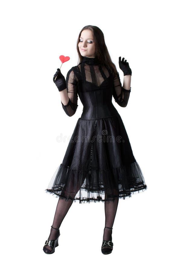 Gotisch meisje met lolly stock afbeeldingen