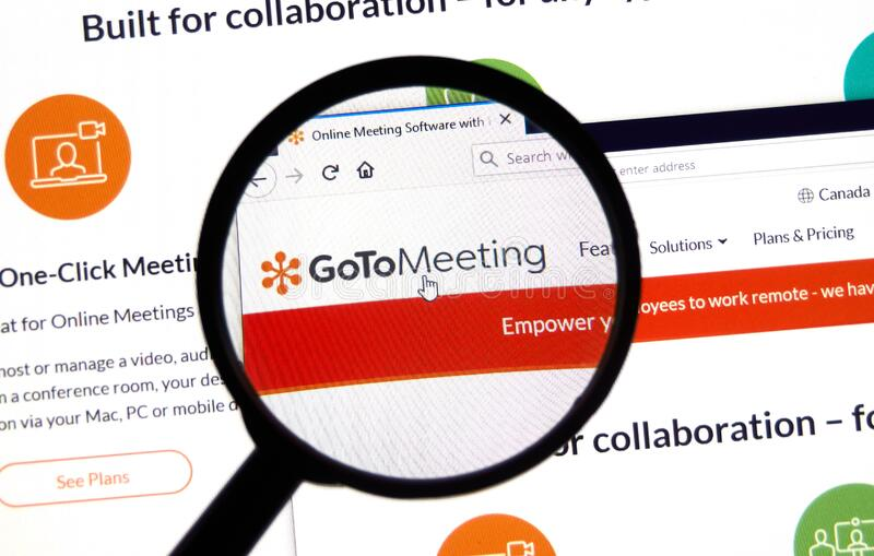 GoToMeeting logo and app on laptop screen. It is an online meeting, desktop sharing, and video software. Montreal, Canada - April 8, 2020: GoToMeeting logo and royalty free stock images
