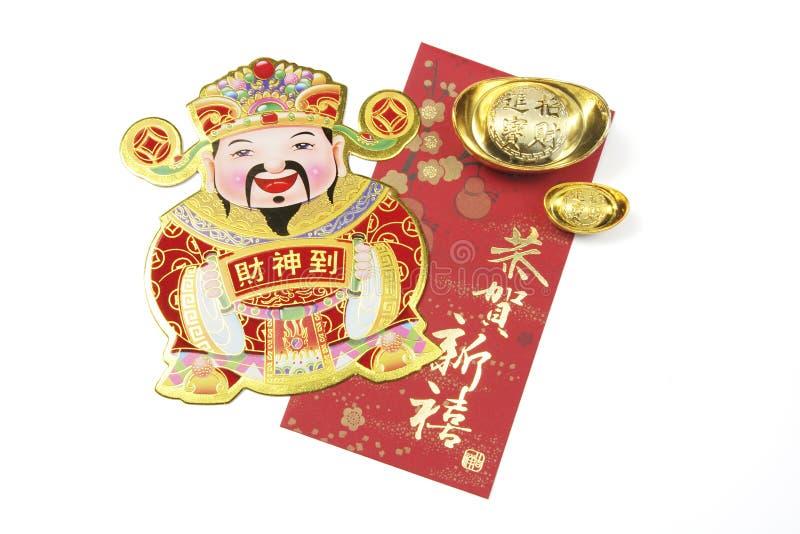 Gott des Reichtums mit Goldbarren und rotem Paket lizenzfreie stockbilder