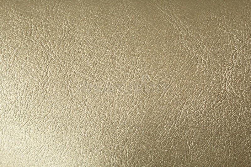 Goud of Brons Natuurlijke Leerachtergrond Glanzende gele de textuurachtergrond van de blad gouden folie Plaats voor tekst royalty-vrije stock afbeelding