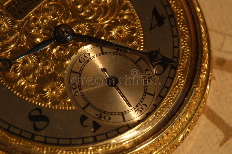 Goud pocketwatch stock afbeelding