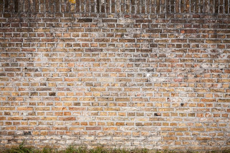 Gouda, South Holland/the Netherlands - February 9 2019: old brick stone wall in the city center of Gouda with quite some patina royalty free stock photo