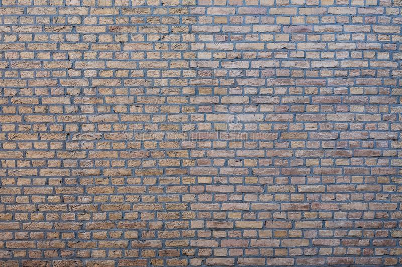 Gouda, South Holland/the Netherlands - January 20 2019: brick stone wall with left older stones and right lighter more smooth and royalty free stock photo