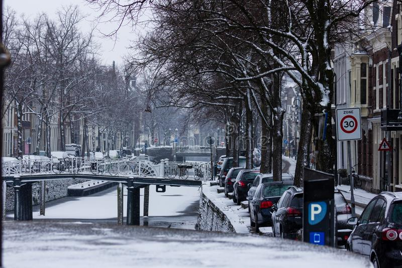 Gouda, South-Holland/The Netherlands - January 22 2019: First real snow in the Netherlands in 2019 a walk through the inner city. Of Gouda bridges and canals royalty free stock photography