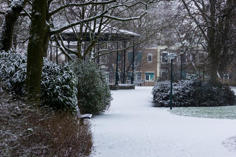 Gouda, South-Holland/The Netherlands - January 22 2019: First real snow in the Netherlands in 2019 a walk through the inner city. Of Gouda Houtmansplantsoen royalty free stock photography