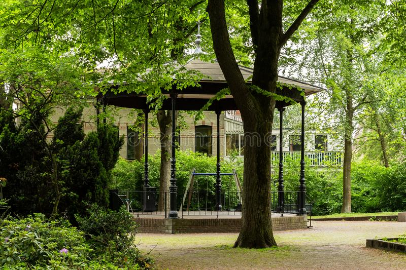 Gouda, South Holland/The Netherlands - May 19 2018: Empty musical stage tent in Gouda city park during a May spring morning. Gouda, South Holland/The Netherlands stock photography