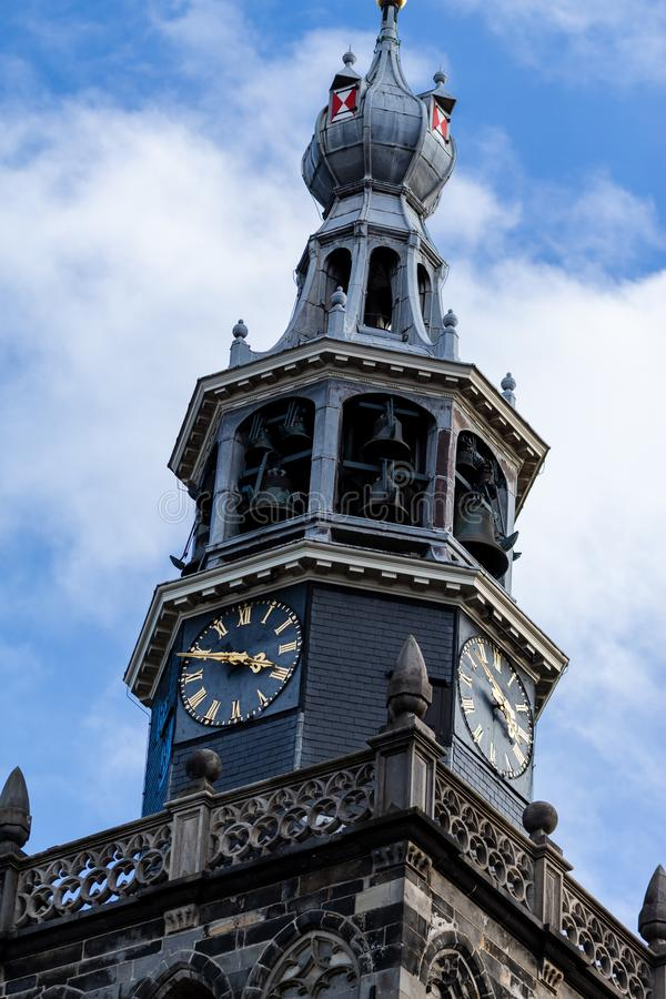 Gouda, South-Holland/The Netherlands - October 27 2018: St. Jan Church clock and bell tower with clouded blue sky as a background. On a sunny October autumn day royalty free stock photography