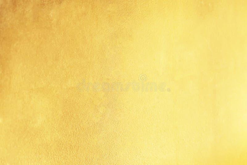 Gouden abstracte achtergrond of textuur en gradiëntenschaduw stock fotografie