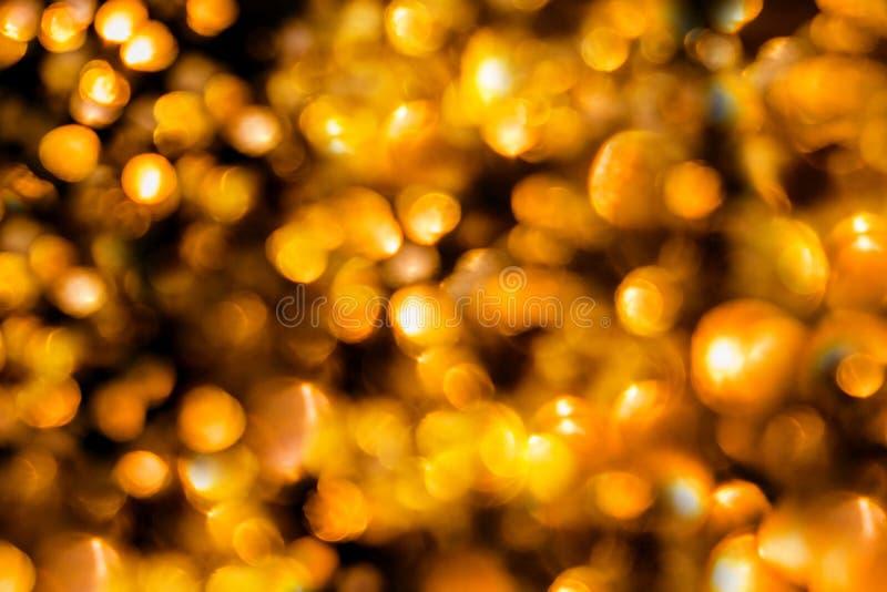 Gouden abstracte bokehachtergrond Nachtlichten royalty-vrije stock fotografie