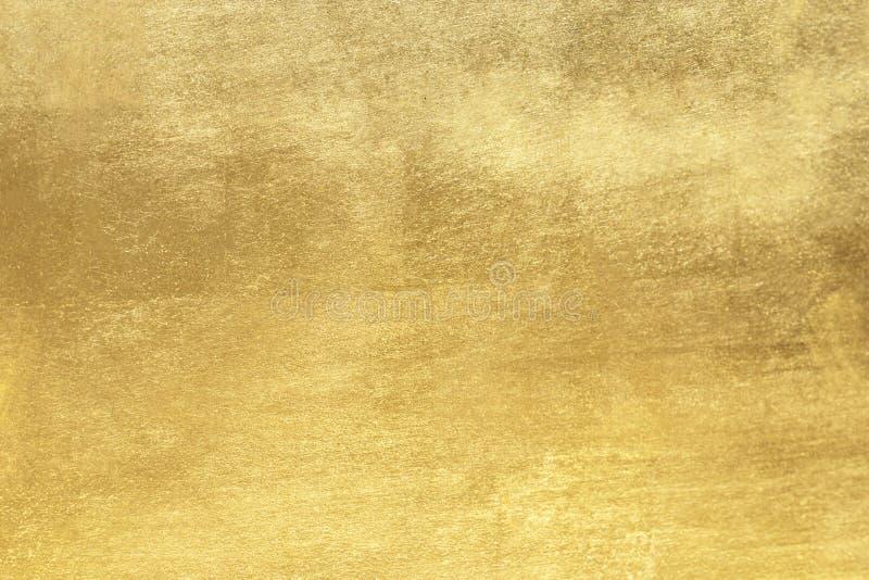 Gouden achtergrond of textuur en gradiëntenschaduw stock foto's