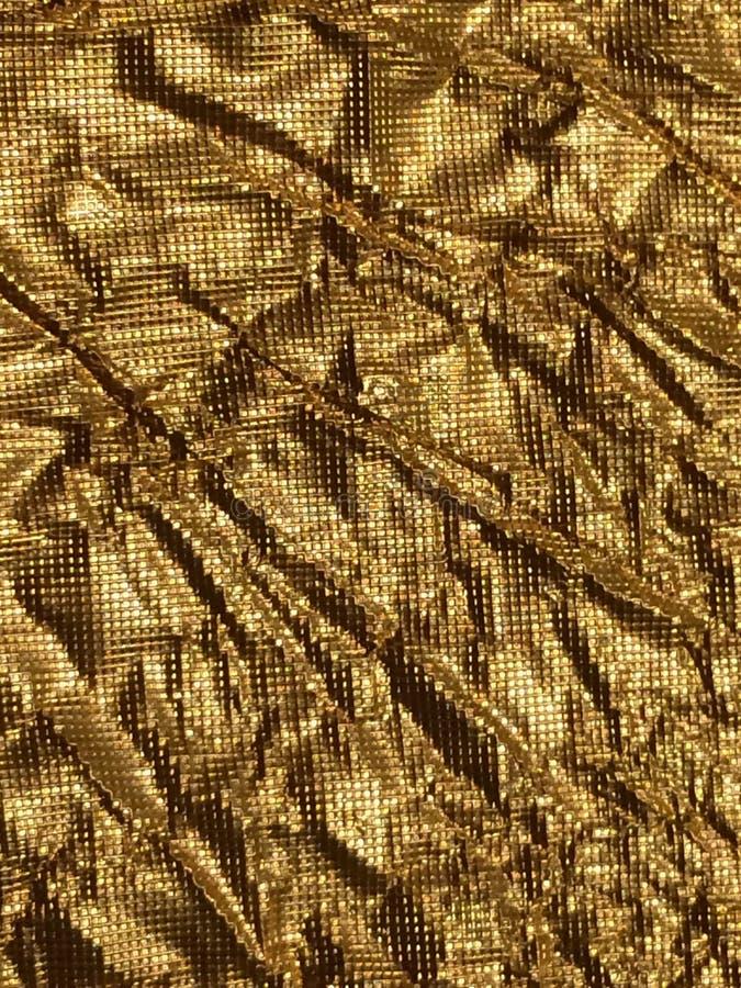 Gouden achtergrondmetaaltextuur stock foto