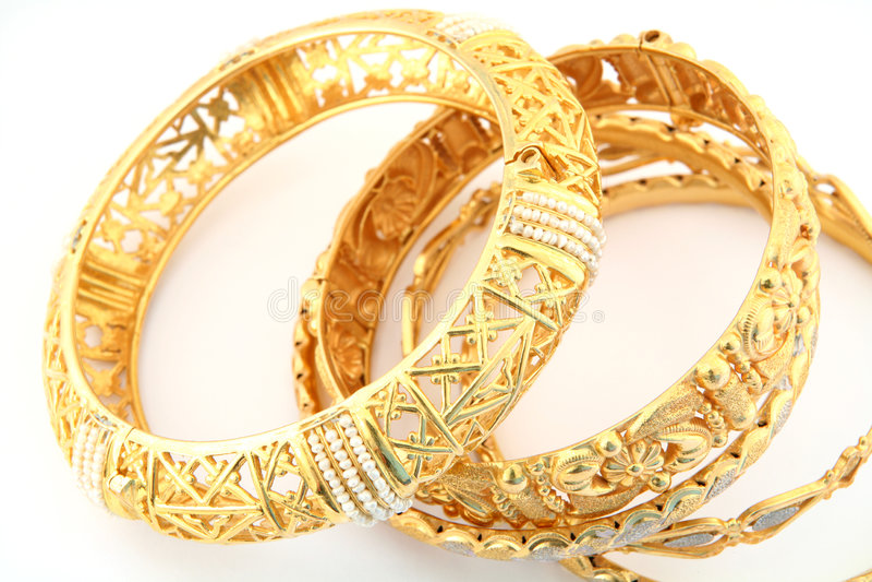 Gouden armbanden 3 stock fotografie
