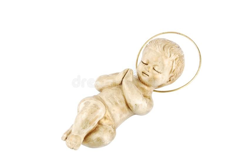 Gouden baby Jesus die op wit ligt royalty-vrije stock foto