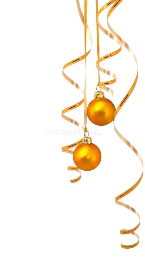 Gouden ballen met klatergoud stock afbeelding