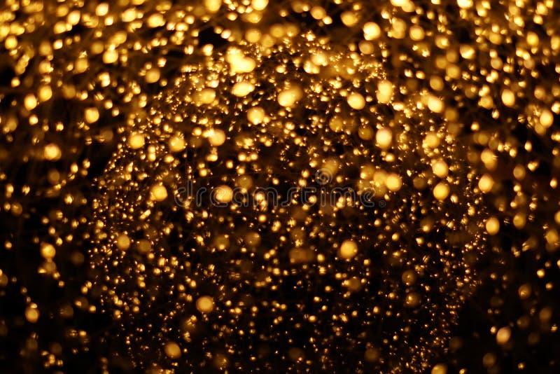 Gouden bokeh vertroebelde abstracte patroonachtergrond royalty-vrije stock foto's