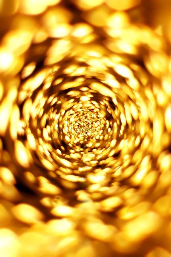 Gouden bokeh vertroebelde abstracte patroonachtergrond royalty-vrije stock afbeeldingen