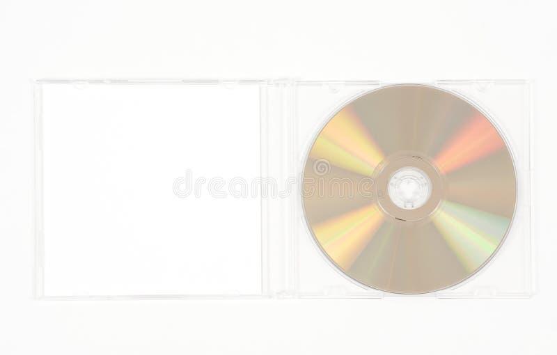 Gouden CD in duidelijk geval stock foto's