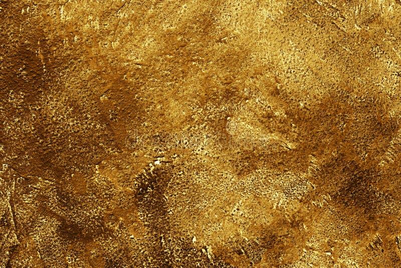 Gouden concrete achtergrond stock foto