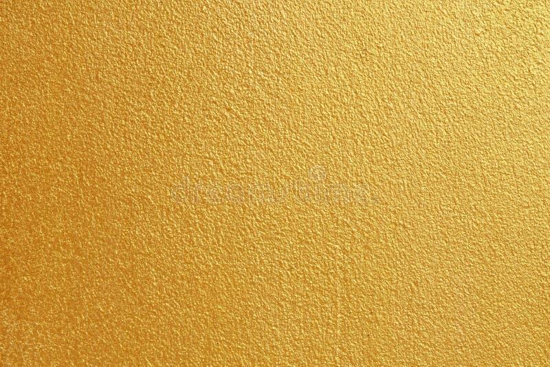 Gouden concrete muur op achtergrondtextuur royalty-vrije stock foto