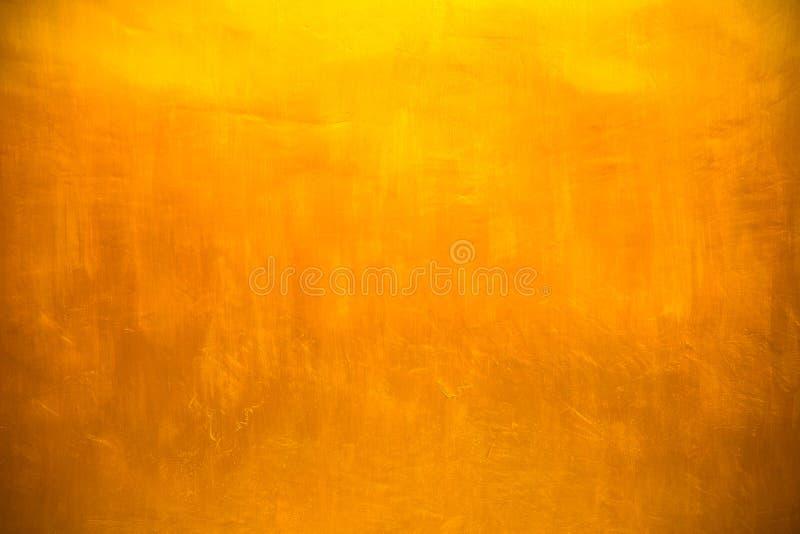 Gouden concrete muur op achtergrondtextuur royalty-vrije stock foto's